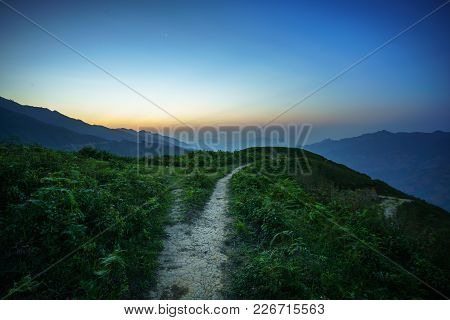 Road On Spine And The Top Of The Mountains Covered With Greenery With Gentle Valleys At Dawn