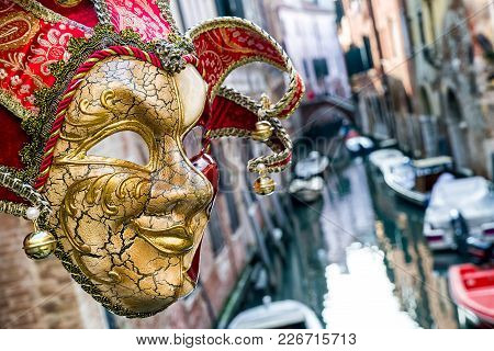 Venice, Italy - February 11: Mask Of Clown And Water Canal At Background During The Carnival Of Veni