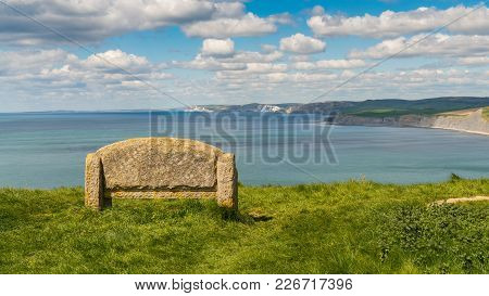 Stone Bench At The South West Coast Path With A View Over The Jurassic Coast, Near Worth Matravers,