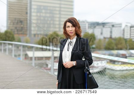Journalist, Woman In Business Clothes Go To Work. Smiling Middle-aged American Lady Wearing Black Ja