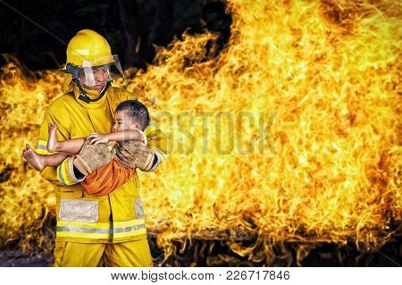 Firefighter., Rescue Fireman Save A Child From Fire Incident.