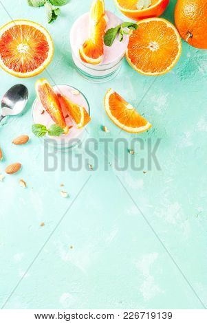 Healthy Breakfast, Blood Orange Parfait With Granola. Yogurt, Almond And Mint, Light Blue Background