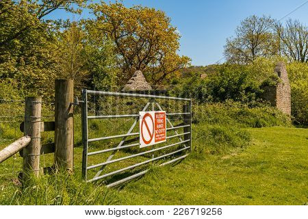 Ruin In The Abandoned Tyneham Village And A Gate, Near Kimmeridge, Jurassic Coast, Dorset, Uk