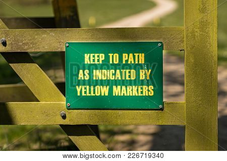 Sign: Keep To Path As Indicated By Yellow Markers, Seen In Tyneham Village, Jurassic Coast, Dorset,