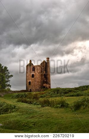 Old Engine House On Bodmin Moor On A Very Cloudy Day, Now Information Centre For Bodmin Moor