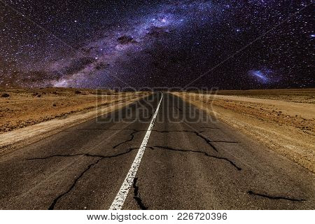 Road In The Mountains Under The Milky Way.