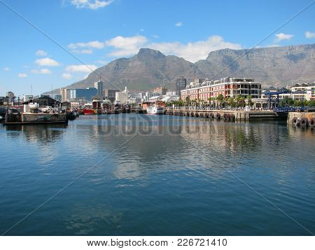 From Cape Town, South Africa, The Victoria And Alfred Waterfront With Calm, Turquoise Water In The F