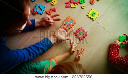 Teacher And Kids Play With Number Puzzle, Learn Calculation
