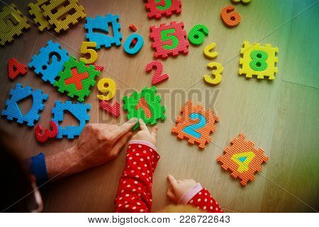 Teacher And Child Play With Number Puzzle, Learn Calculation