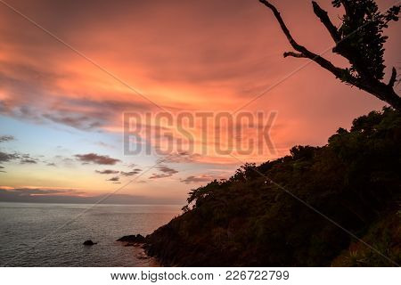 Dramatic Tropical Sunset Over The Ocean With Clouds