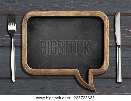 menu chalboard frame on black wooden dinning table