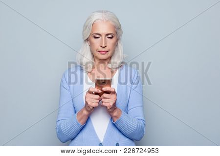 Concept Of Easy, Fast Usage Of Modern Technology Among All Ages. Portrait Of Confident Mature Woman