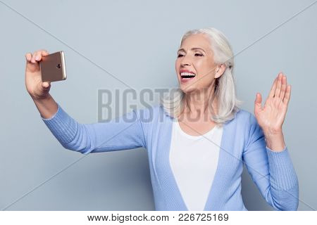 Portrait Of Excited Happy Cheerful Delightful Joyful Charming Mature Lady Granny Tourist Using Her S