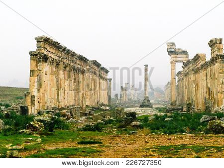 Great Colonnade At Apamea In Fog, Partially Destroyed By Isis, Syria
