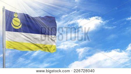 Flag Of Buryatia On Flagpole Against The Blue Sky.