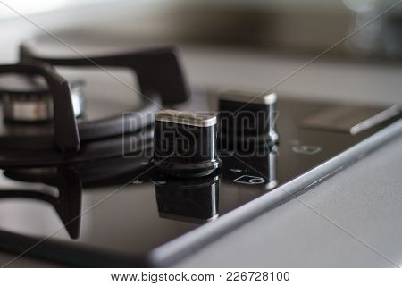 Stainless Steel Gas Hob Detail On Black Stone Worktop, Close-up, Matte Black Stylish Two Burner Smal