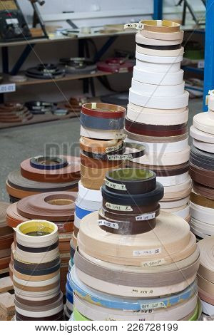 Multicolored Bobbins Of Pvc Edge And Melanin For The Manufacture Of Furniture.
