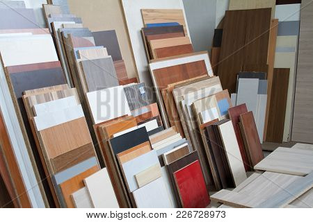 A Pack Of Parts Of A Particleboard In The Furniture Manufacturing. Cutting Of Fiberboard Of Differen