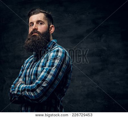 Studio Portrait Of Bearded Male With Crossed Arms, Dressed In A Blue Fleece Shirt.