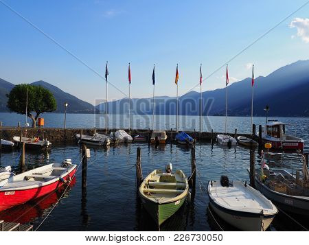 Ascona, Switzerland Europe On July 2017: Colorful Boats In Haven In Travel City With View On Lake Ma