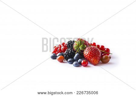 Mix Berries Isolated On A White. Ripe Blueberries, Blackberries, Currants And Strawberries. Berries