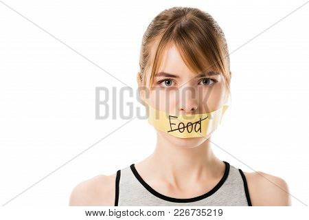 Woman With Stiker With Striked Through Word Food Covering Mouth Isolated On White