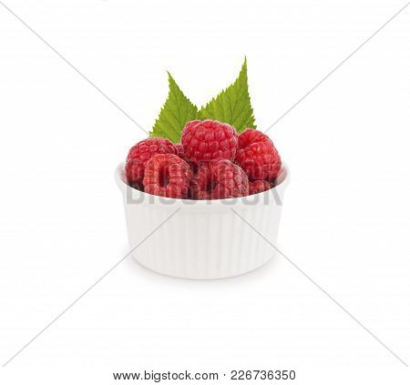 Raspberries In A Bowl Isolated On White Background. Vegetarian Or Healthy Eating. Juicy And Deliciou