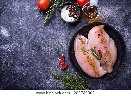 Raw Chicken Fillet In Cast Iron Pan. Top View