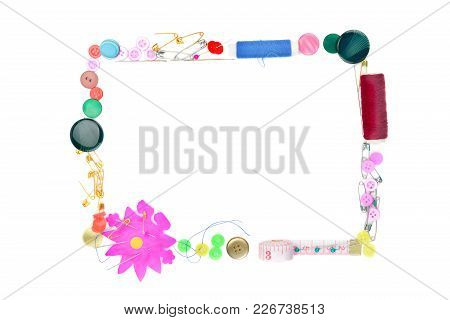 Sewing Accessories Isolated On White Background. Colorful Frame Of Buttons, Threads And Needles. Fre