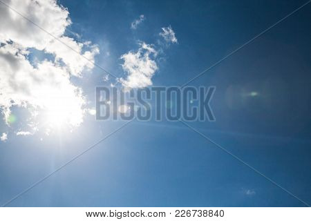 Blue Sky With Clouds And Sun. A