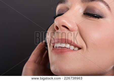 Close-up Of Beautiful Young Lady Listening To Headphones