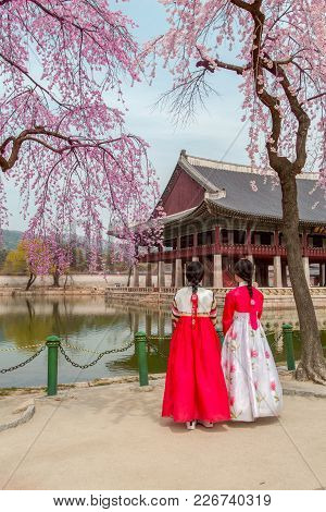 Gyeongbokgung Palace With Korean National Dress And Cherry Blossom In Spring Seoul,south Korea