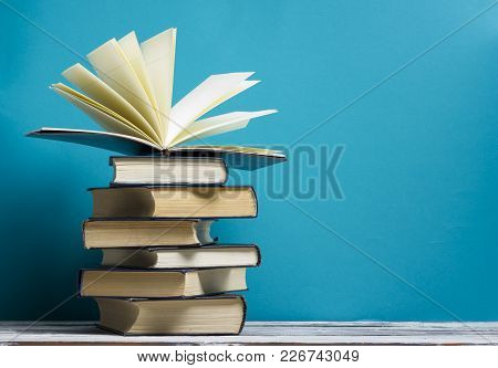 Open Book, Hardback Books On Wooden Table. Back To School. Copy Space.