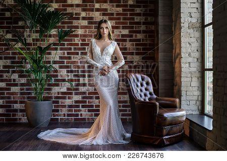 Beautiful Wedding Dress. Bride In A Luxury Apartment In A Wedding Dress. Bride In Beautiful Dress St