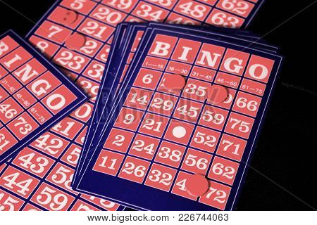 Playing  Bingo Card On A Black Background