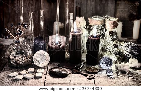 Black Candles With Runes, Crystals, Old Key, Healing Herbs And Magic Ritual Objects Halloween, Occul