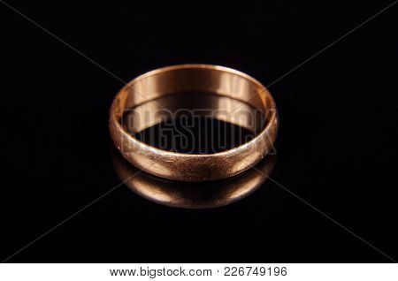 Yellow Golden Wedding Ring With Many Scratches