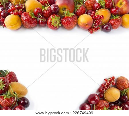 Red And Yellow Fruits On White Background. Ripe Apricots, Red Currants, Cherries And Strawberries. S