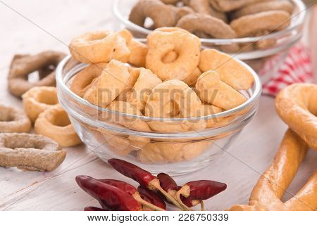 Italian Taralli With Spices On Wooden Table.