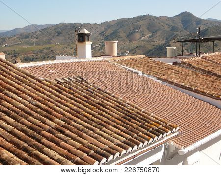 New Roof Between Traditional Arabic Style Roof Tiles On House In Alora, Andalusia