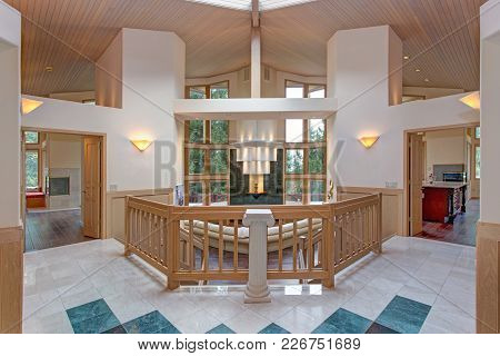 Chic Grand Entrance Foyer Design With Double Sided Staircase