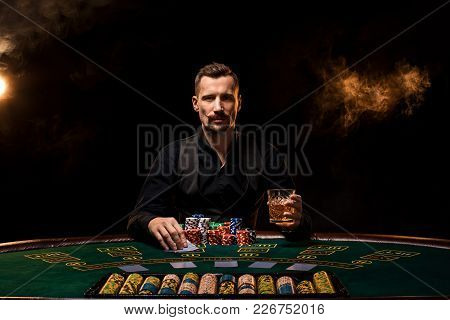Poker Player. Young Guy In The Casino At The Gaming Table. Man Gambling, Card Games. Cards, Chips, W