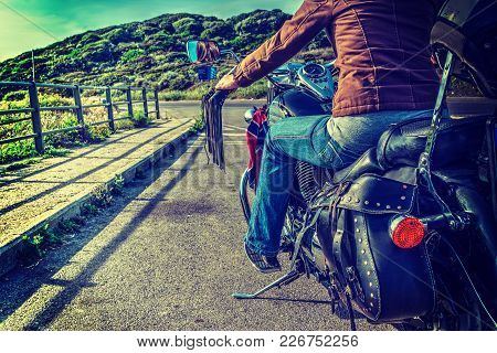 Girl On A Classic Motorcycle On The Edge Of The Road