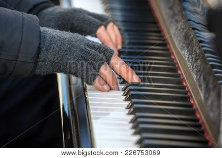 The Pianist Plays The Piano Outside In Winter