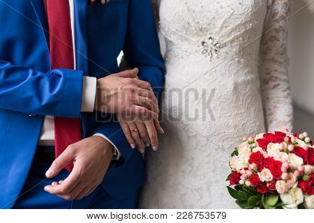 Hands Of Married Couple With Rings. Couple In Love