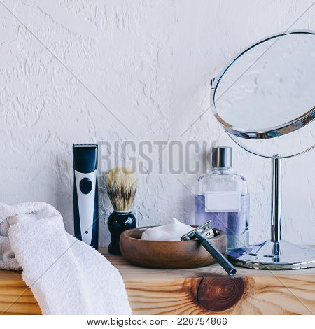Close Up View Of Arranged Barber Equipment For Shaving On Wooden Shelf