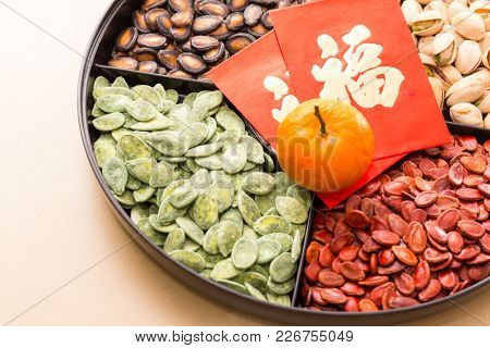 Snack tray for lunar new year with red packet of word means luck