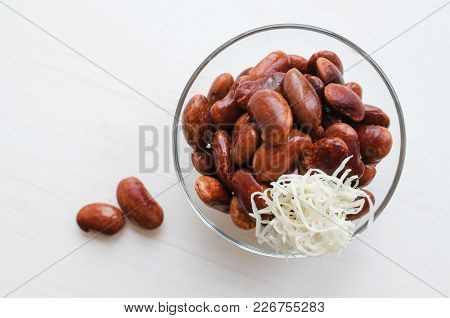 Red Canned Beans In Glass Bowl With Horse-radish Over White Background