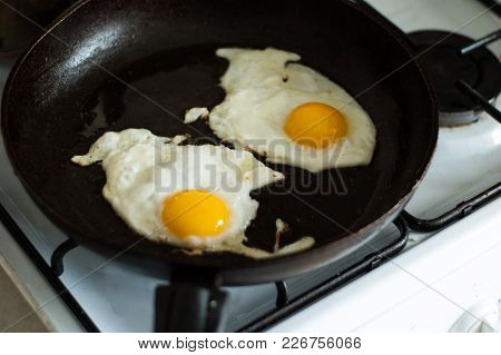 Two Fried Eggs In A Frying Pan.