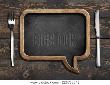 menu blackboard frame on wooden dinning table